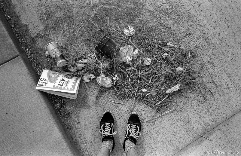 Trent feet and trash in gutter