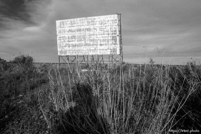Trent shadow and old drive-in theater screen.