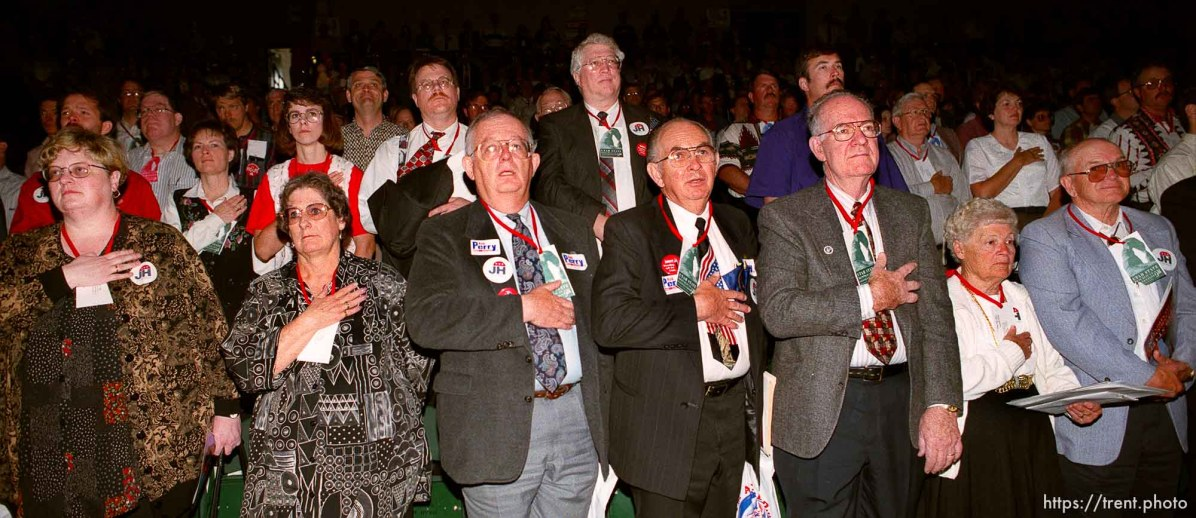 Republicans put their hands over their hearts while the national anthem plays at the Utah State Republican Party Convention, held at Utah Valley State College.