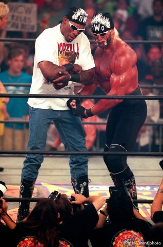Dennis Rodman and Hollywood Hulk Hogan flex for the cameras at WCW's Bash at the Beach.