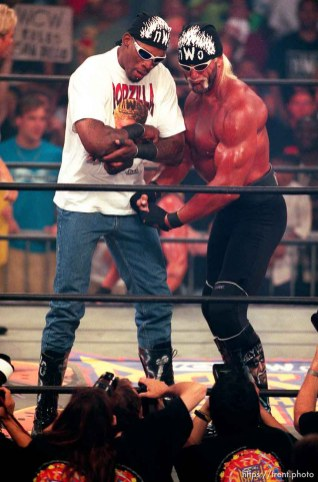 Dennis Rodman and Hollywood Hulk Hogan flex for the cameras at WCW's Bash at the Beach.