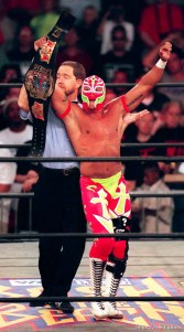 Rey Mysterio Jr. holds a championship belt at WCW's Bash at the Beach.
