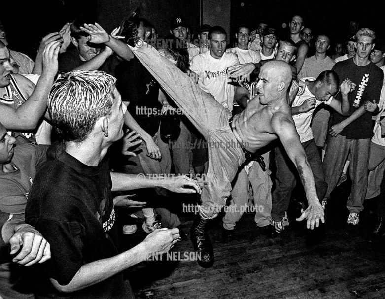Hardcore punks and straightedge kids thrash in the pit to the band Ookla the Mok, performing at the Tower Theater in Salt Lake City, Utah. August 16, 1998. In the mid 90's after numerous violent incidents, the Salt Lake City Police Department formally declared straightedge a violent gang. photo copyright - Trent Nelson. http://www.trenthead.com