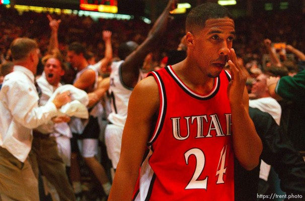 Utah's Andre Miller walks off the court as Utah State celebrates their win over 9th ranked Utah at Utah vs. Utah State.