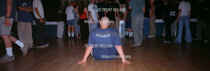 "Straightedge kid with ""belcher"" on his shirt, sitting down in the pit at Fury 66 show at the Whittier Community Center."
