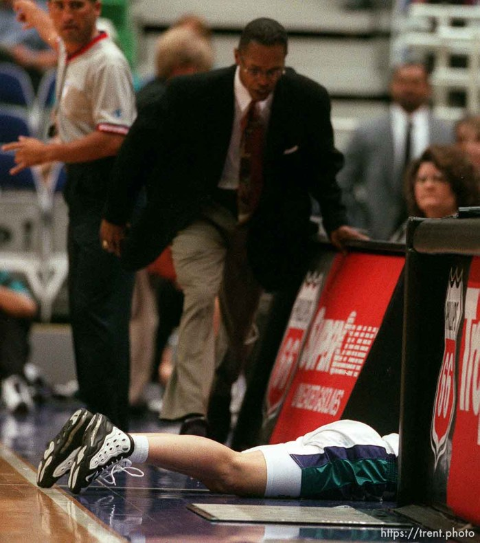 Starzz coach Fred Williams runs over to check on guard Debbie Black after she dove through the scorer's table chasing a loose ball vs. the Los Angeles Sparks. Black was unhurt.