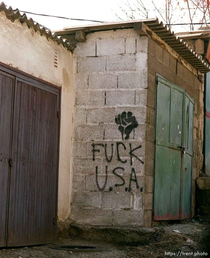 FUCK USA and black fist graffiti in North Mitrovica