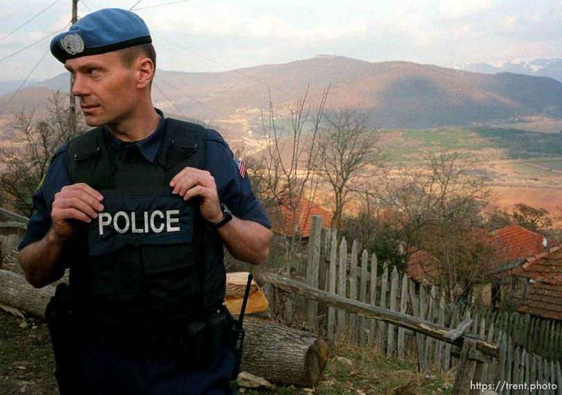 UNMIK police officer Zane Smith working on a homicide case in a hillside village in Northern Kosovo