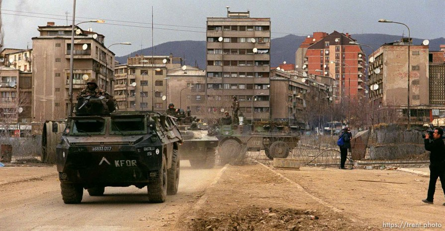 KFOR troops on the main bridge seperating North (Serb) and South (Albanian) Mitrovica. This is looking north.