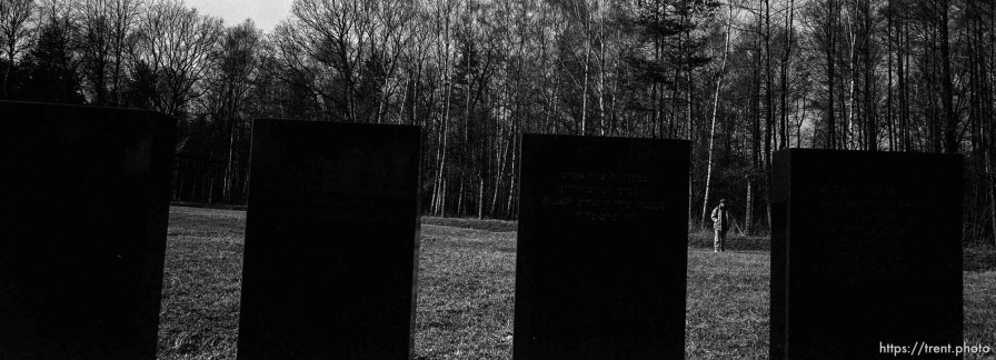 walking in field where bodies were burned at the Birkenau Concentration Camp.