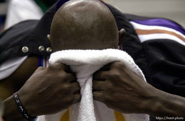 Olden Polynice puts his face in a towel at the end of Utah Jazz vs. Portland Trailblazers. Game 3, 2nd round NBA Playoffs. Trailblazers won to take 3-0 advantage in series, which they eventually won.