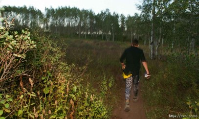 David Terry runs through an alpine meadow near the Alpine Loop aid station. Wasatch 100 Endurance Run.