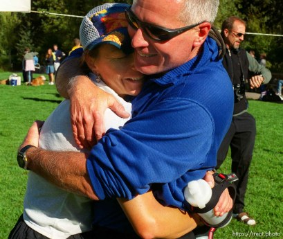 Dave Lehman hugs his wife, runner Ruth Zollinger, at the end of the race, Sundance Ski Resort. Wasatch 100 Endurance Run.