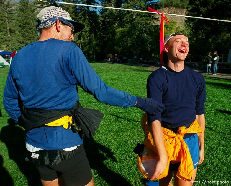 Garett Graubins (right) shares a laugh with his friend and pacer Jeff Stevenson, at the end of the race, Sundance Ski Resort. Wasatch 100 Endurance Run.