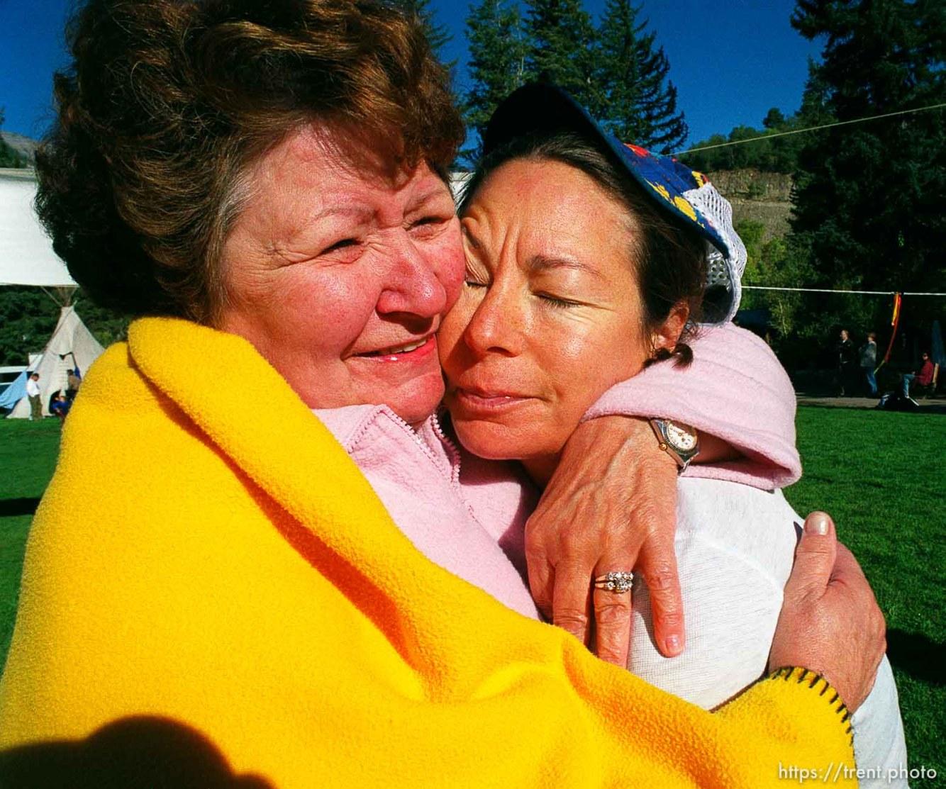 BarDonna Zollinger embraces her daughter, runner Ruth Zollinger, at the end of the race, Sundance Ski Resort. Wasatch 100 Endurance Run.