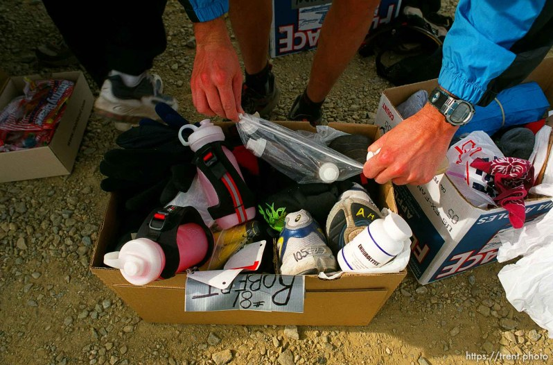 Dave Tavernini going through his gear at the first checkpoint. Runner near Francis Peak. Wasatch 100 Endurance Run.
