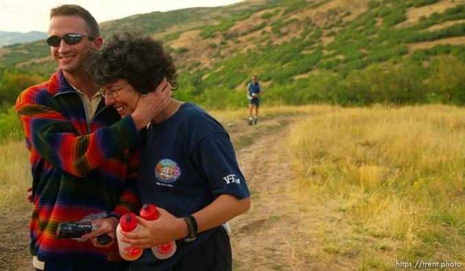 David Wick embraces runner Monica Scholz near the Lambs Canyon aid station. Wasatch 100 Endurance Run.