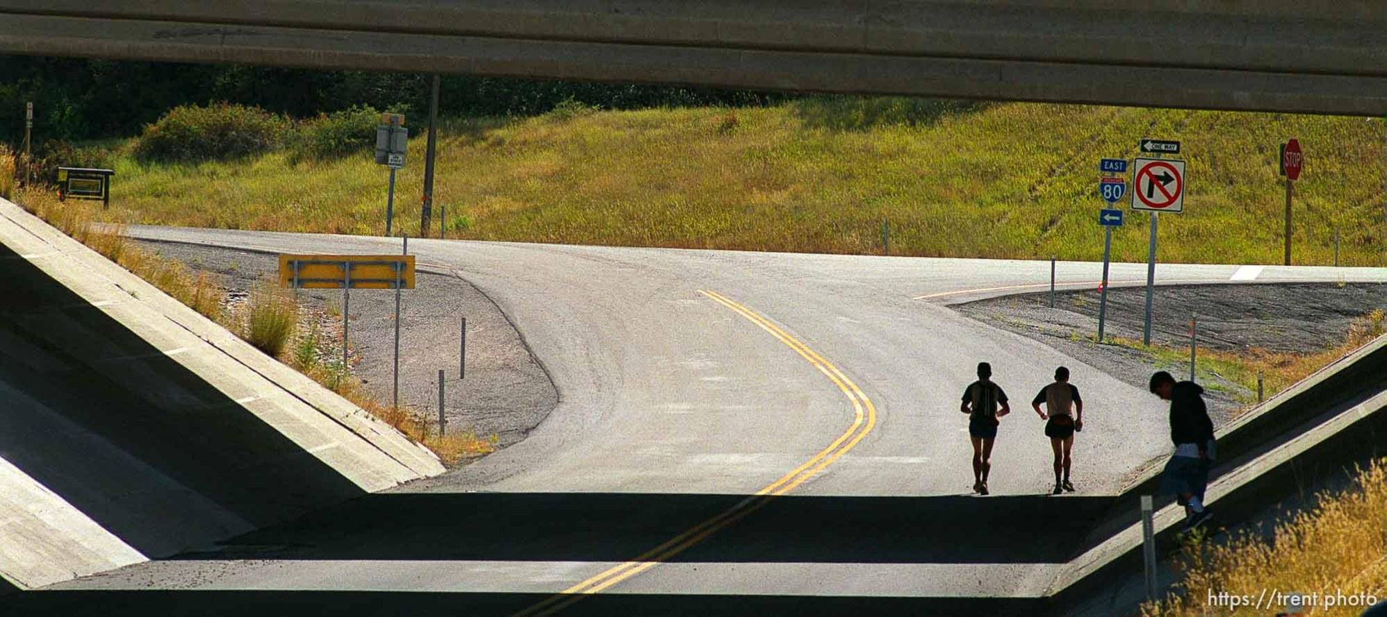 Mark Hartell and Mark McDermott run under I-80 near the Lambs Canyon aid station. Wasatch 100 Endurance Run.