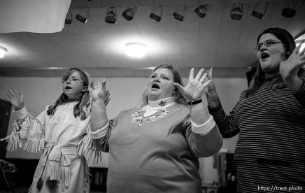 Chastadi Reeve, RaVae Bobo, April Marden singing. Thanksgiving dinner at the Salt Lake City Mission.