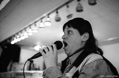 Monica Wilson sings Thanksgiving dinner at the Salt Lake City Mission.