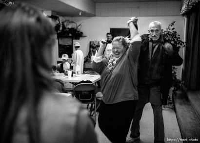 Julie Reeve and Robert Carothers dance Thanksgiving dinner at the Salt Lake City Mission.