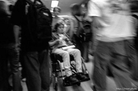 Peer tutor Alicia Cochran pushes Michelle Salisbury through the crowded halls of Sky View High School.