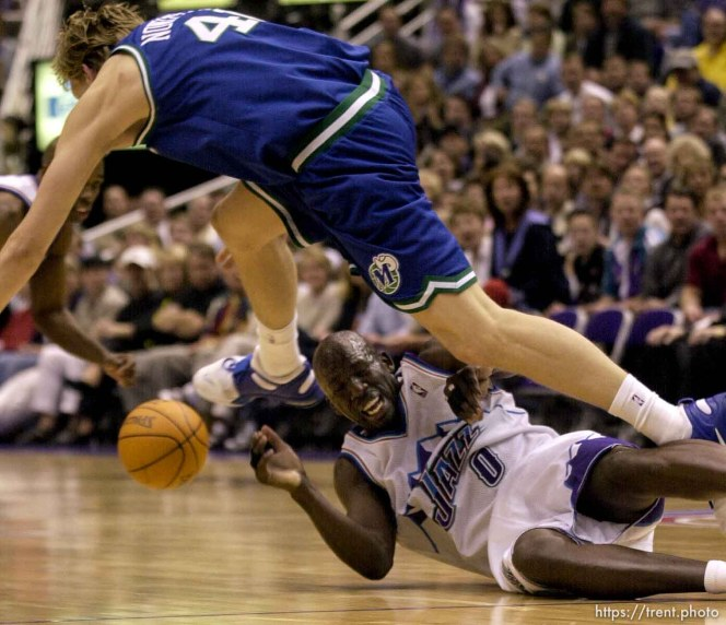 Dirk Nowitzki goes over Olden Polynice as the Utah Jazz face the Dallas Mavericks in game five of their first round playoff series, in Salt Lake City Thursday.