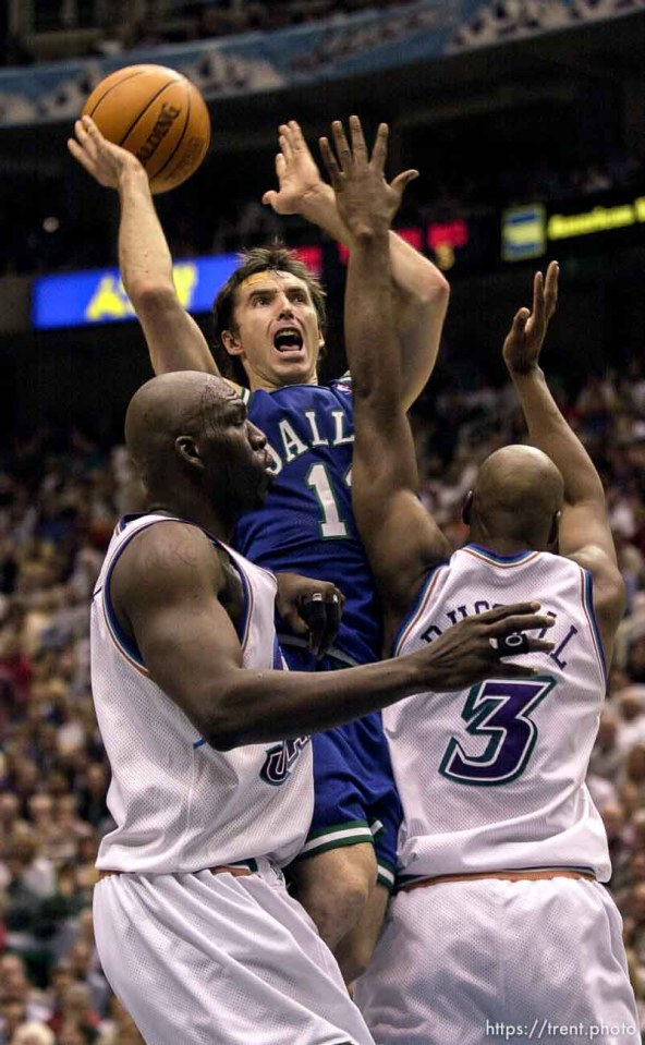 Steve Nash shoots as the Utah Jazz face the Dallas Mavericks in game five of their first round playoff series, in Salt Lake City Thursday. 05/03/2001