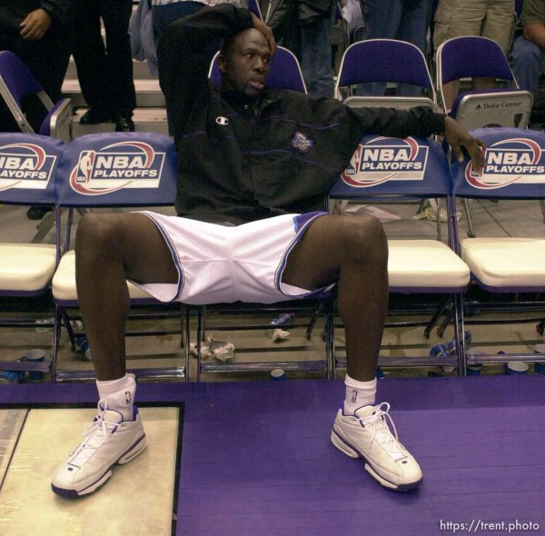 Olden Polynice on the bench alone after losing the series as the Utah Jazz face the Dallas Mavericks in game five of their first round playoff series, in Salt Lake City Thursday. 05/03/2001