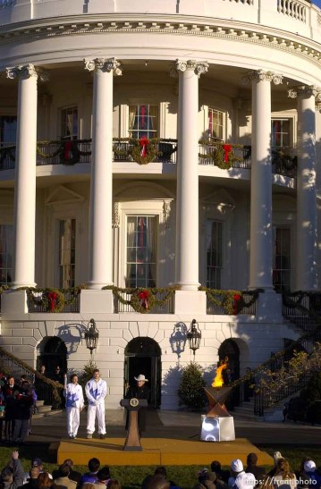 The Olympic Torch comes to the White House. Elizabeth Howell runs it in, President George Bush lights the cauldron, and Eric Jones runs it out. 12.22.2001, 6:32:15 AM