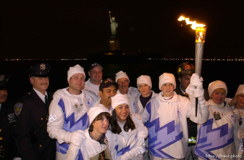 The Olympic Torch commemorates victims and heroes of the World Trade Center attack on a boat near the Statue of Liberty, then proceeds to Rockefeller Plaza where Mayor Giuliani carried the final torch and lit the Olympic cauldron. 12.23.2001, 5:37:23 PM