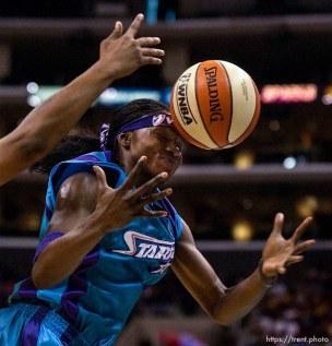 The ball bounces on Starzz guard Marie Ferdinand. Los Angeles Sparks vs. Utah Starzz, game two, WNBA playoffs. 08.24.2002, 2:29:04 PM