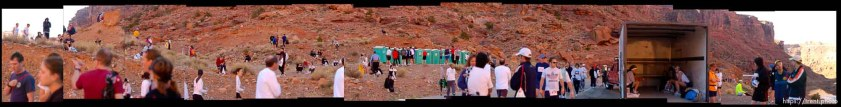 Runners waiting on red rock for the start of the Canyonlands Half Marathon in Moab
