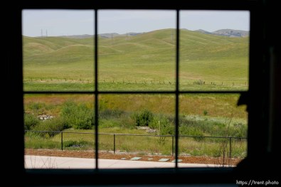 window looking out on the green hills. Windemere model home tour; 5/1/04