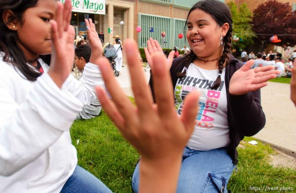 girls playing taxi taxi. Midvale Elementary held a Cinco de Mayo celebration Thursday afternoon, as students enjoyed the mariachi band Sol de Jalisco. 05/05/2005