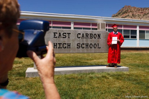 ECHS graduate Justin Ward has his photo taken by his grandmother Betty Marx in front of the school.