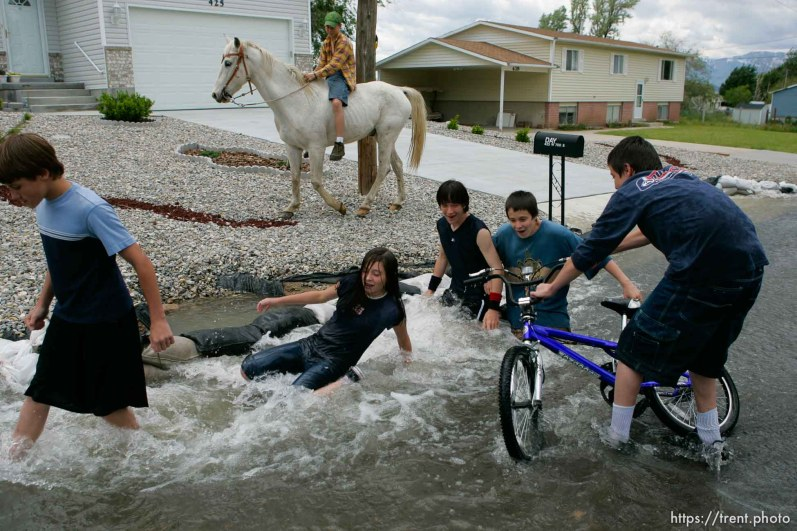 Kids playing in flood water. Flooding along 700 South in Tooele Tuesday. Todd Collins, Jeze Lords, Jesse Riddle, David Lords, and Daniel Lords