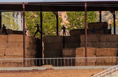 Boys leaping on hay bales, Colorado City