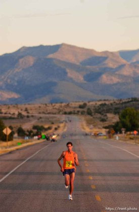 the day's first sunlight hits leader Isaac Barnes. St. George Marathon