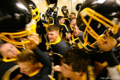 Cottonwood pre-game in the locker room. Cottonwood vs. Highland high school football.