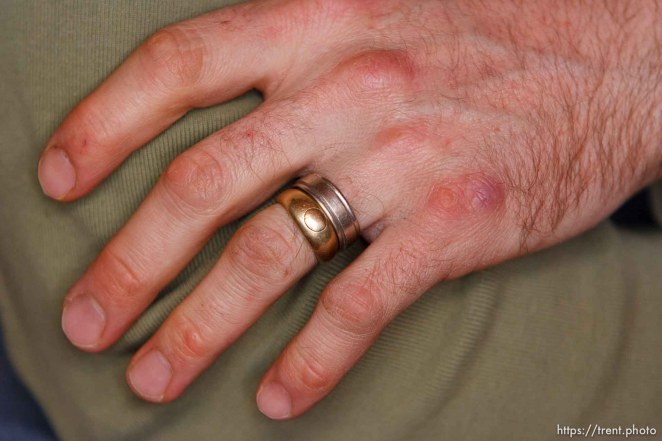 Polygamy, man with his two wives, two wedding rings. The Rock, a fundamentalist Mormon community south of Moab.