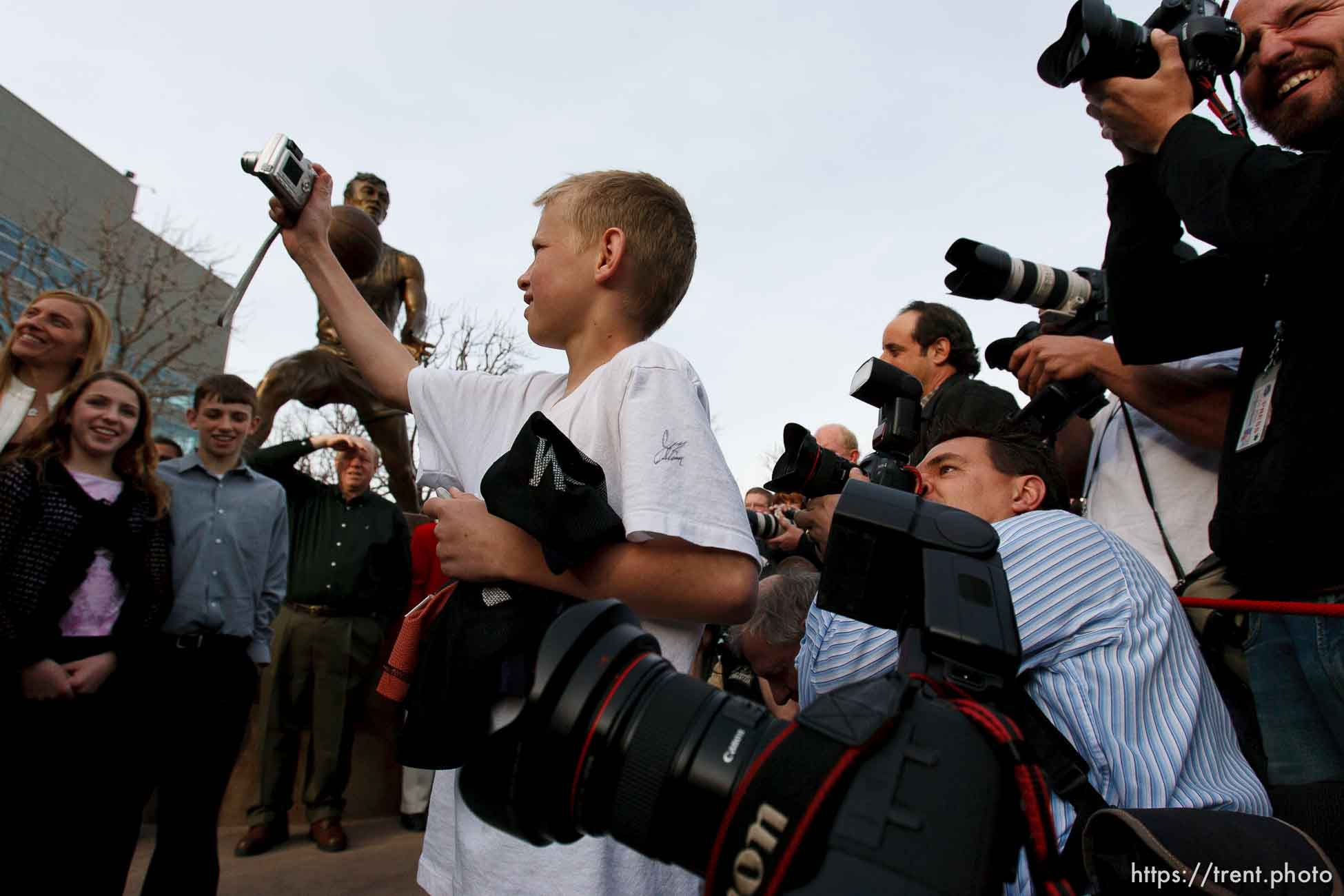 kid among photographers. Karl Malone statue ceremony at the Delta Center. 3.23.2006