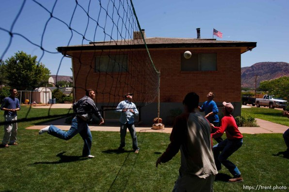 Colorado City - Young men from the fundamentalist community of Centennial Park, Arizona, serve work missions after they graduate high school. They work construction or other jobs, help the needy, and do volunteer work. Here, they play volleyball during a lunch break.. ; 7.25.2006