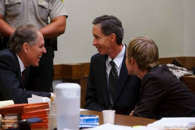 St. George - Warren Jeffs (center) speaks with two of his attorneys, Richard Wright (left) and Tara Isaacson (right) during a break in the victim's testimony. Preliminary hearing, Warren Jeffs trial, 5th District Court.