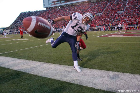 The ball flies incomplete past Brigham Young tight end Jonny Harline (13) on the second to last play of the game. BYU wins with no time on the clock. Salt Lake City - Utah vs. BYU college football at Rice-Eccles Stadium.