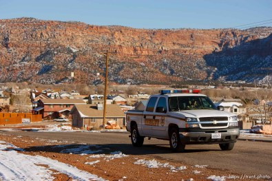 "Hildale - Washington County Sheriff Deputy Darrell Cashin patrolling Hildale, Utah. Cashin was assigned to the FLDS town of Hildale, Utah in November. On making inroads into the closed community, Cashin said, ""It's going to take time. They need to see that they can trust me."".. for FLDS Hildale/Colorado City Town Marshal story; 12.20.2006"