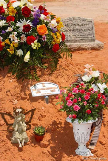 "Colorado City - A mound of dirt and small placard mark Norene Jeffs' simple grave, next to that of Rulon Jeffs, her husband. Friends and family members of Norene Jeffs gathered in the Colorado City cemetery to remember this plural wife, who had been buried the previous week in a secret funeral by members of the Fundamentalist Church of Jesus Chris of Latter-Day Saints (FLDS). Jeffs, who had been ""sealed"" to the previous FLDS prophet Rulon Jeffs (Warren Jeffs' father), was buried even before family members exiled from the secretive church were notified of her death. 7.09.2007"
