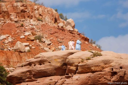 flds woman and girls on red rocks
