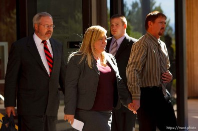 St. George - Warren Jeffs trial. The polygamous sect leader was charged with two counts of rape as an accomplice stemming from a marriage he officiated involving a 14-year-old girl and her 19-year-old cousin. jane doe (the victim) comes out to make a statement with her husband and lawyer Roger Hoole . Elissa Wall