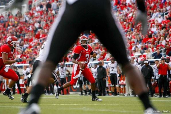 Salt Lake City - Utah quarterback Brian Johnson scrambles. Utah vs San Diego State (SDSU) college football at Rice-Eccles Stadium.